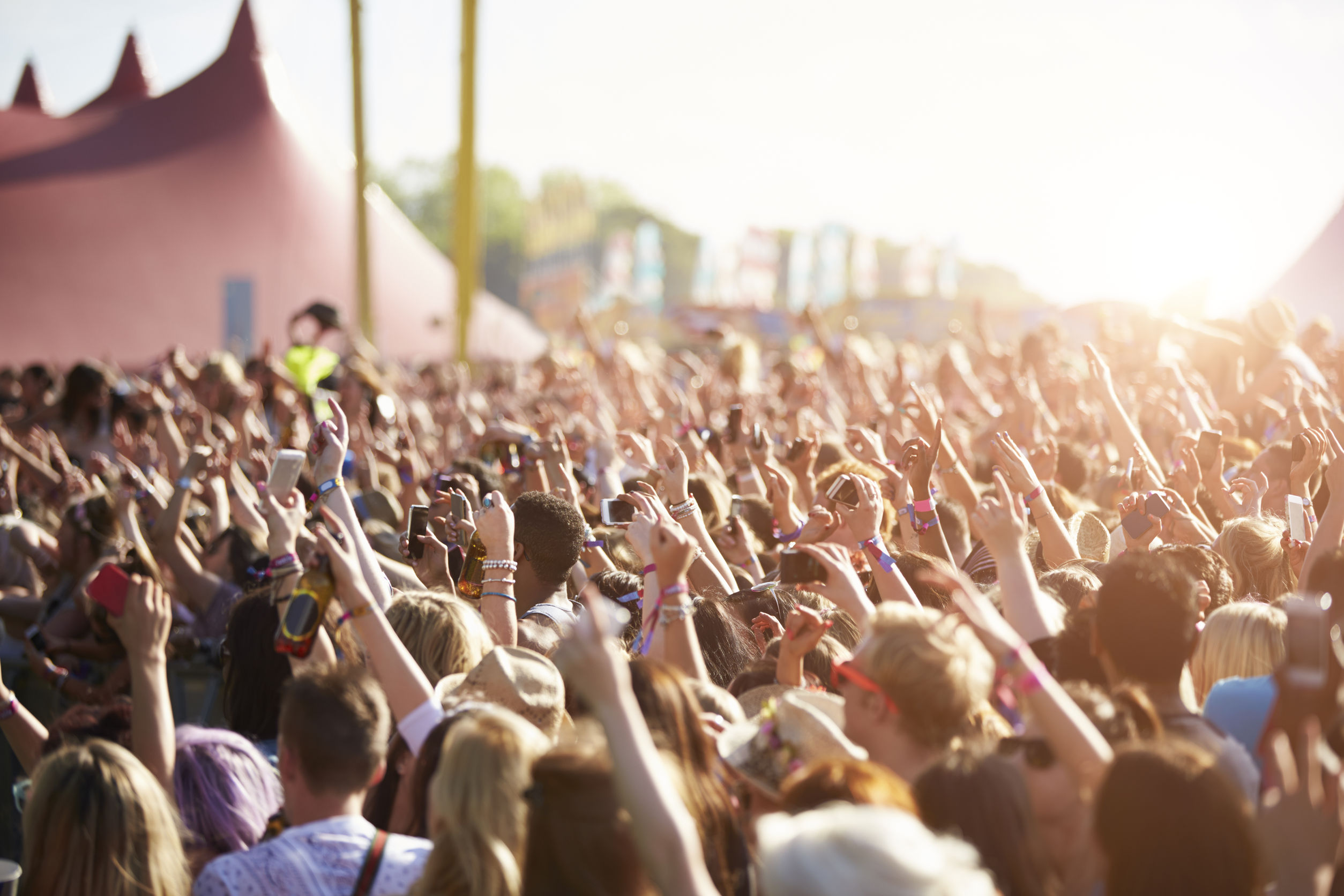 An image of an audience at an outdoor festival